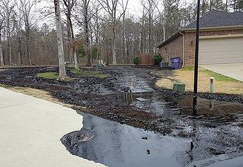 Oil spilled from exxonMobil's Pegasus pipeline in Mayflower, Arkansas neighborhood, March 29, 2013 (Photo courtesy U.S. EPA)