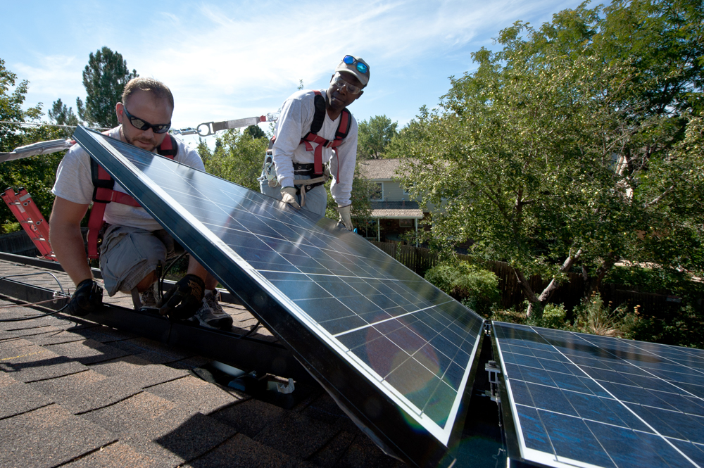 September 10, 2012- REC Solar employees Brian Webster, left and Mario Richard, right, install PV modules on a Englewood, Colorado home participating in the Solar Benefits Colorado program. (Photo by Dennis Schroeder / NREL)