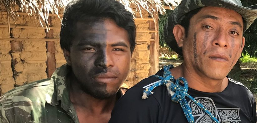 """Guardians of the Forest"" Paulo Paulino Guajajara (left) and Laércio Guajajara (right) pose for a photo before going on patrol in the Araribóia indigenous reserve, in Maranhão state, on Jan 30, 2019. (Photo: Karla Mendes/Mongabay)"