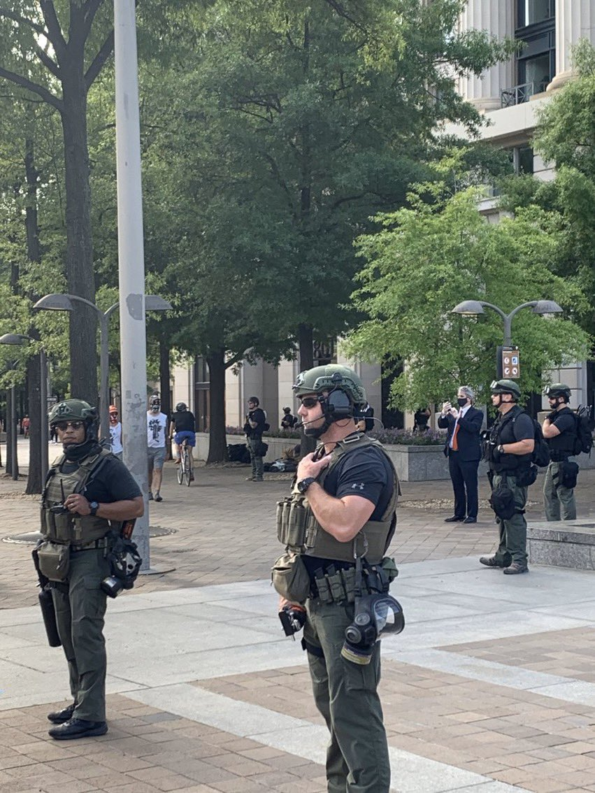 police without nameplates or insignia on the streets of DC