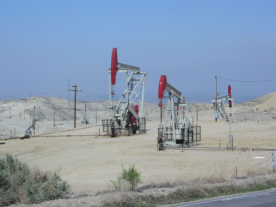 Three active oil wells (using nodding donkeys) in Elk Hills Oil Field, located south of Buttonwillow, California. Photo courtesy of Wikipedia.