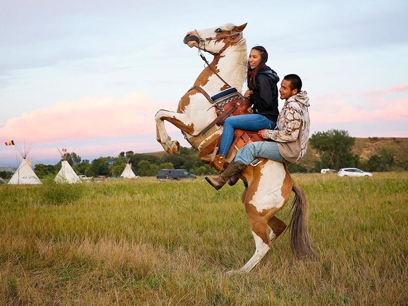 Standing Rock DAPL Stevana Salazar (left) of the Kickapoo Tribe of Texas rides with Arlo Standing Bear, Oglala Lakota from Allen, S.D., in the Sacred Stone Camp, Aug. 26, 2016. TERRAY SYLVESTER / VWPICS VIA REDUX