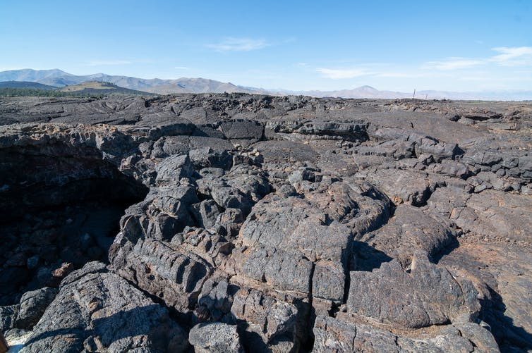 Weathering of rocks like these basalt formations in Idaho triggers chemical processes that remove carbon dioxide from the air. Matthew Dillon/Flickr, CC BY